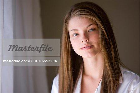 Portrait of Brunette Woman near Window