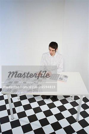 Man doing crosswords