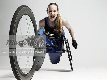 Overjoyed female wheelchair athlete