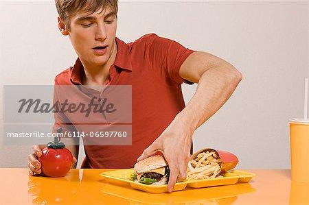 Man with burger meal