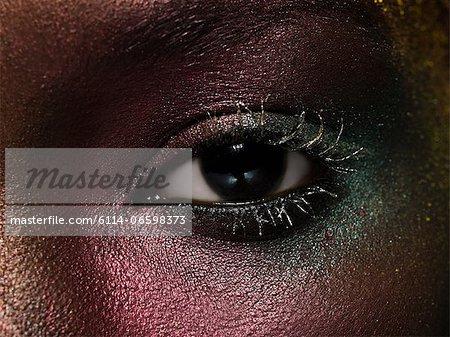 Female eye covered in metallic make up