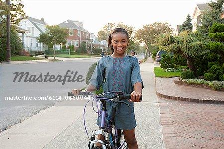 Young girl on bicycle