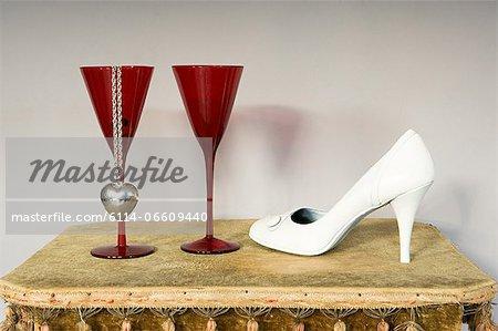 Necklace wine glasses and stiletto