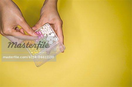 Woman holding a pillbox