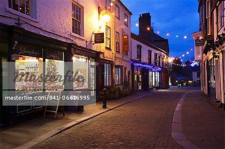 Independent shops and Christmas lights on Kirkgate, Ripon, North Yorkshire, Yorkshire, England, United Kingdom, Europe
