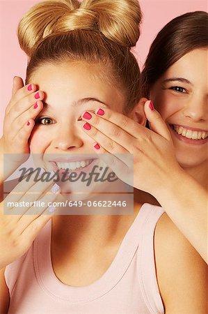 Teenage girls playing together