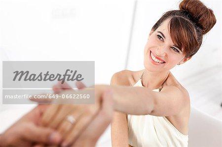 Man admiring fiances engagement ring
