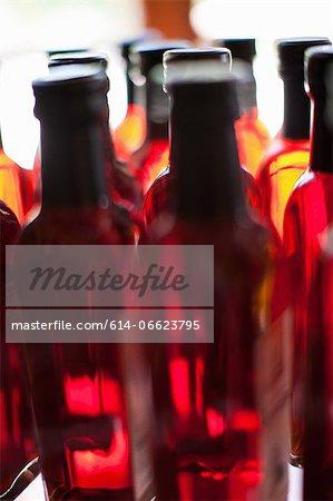 Close up of vinegar bottles on shelf