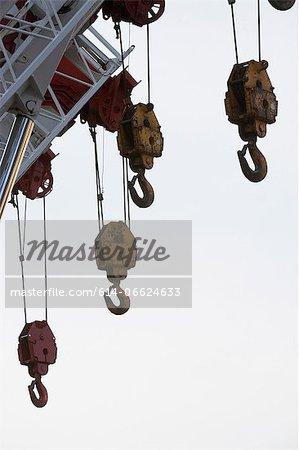 Hooks hanging from crane