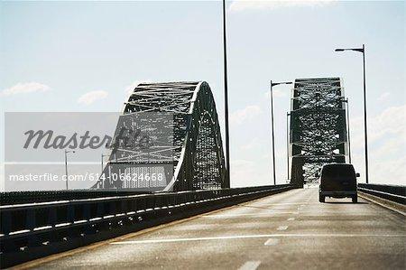 Van driving on bridge