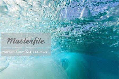 Crashing wave viewed underwater