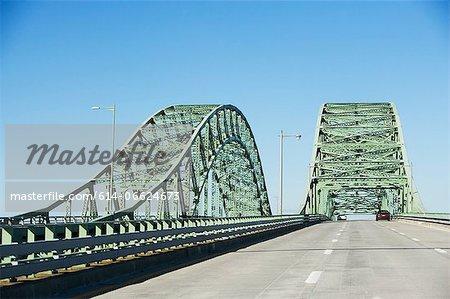 Cars driving on bridge