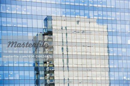 Skyscraper reflected in windows