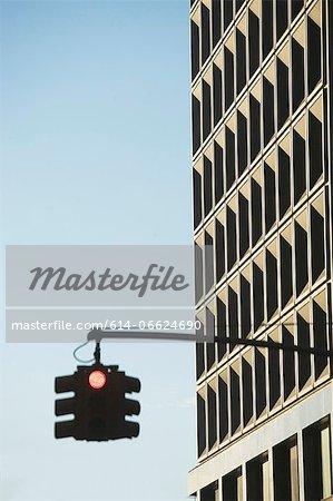 Traffic light and skyscraper