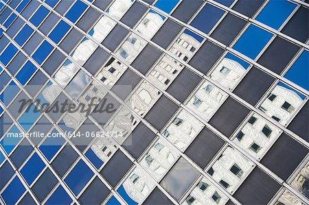 Urban skyscraper reflected in windows