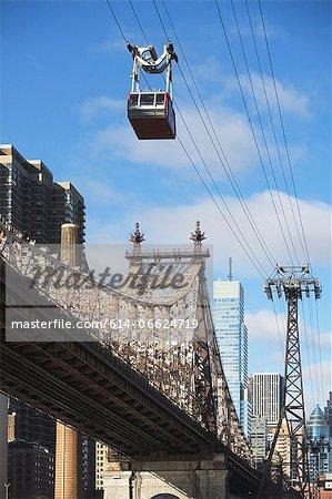 Chairlift over urban bridge