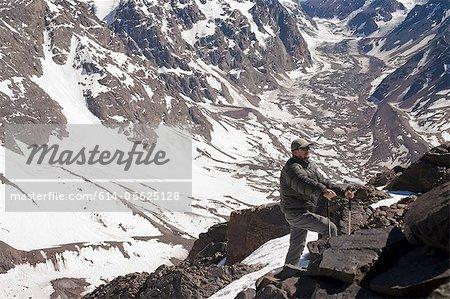 Hiker walking on rocky mountainside