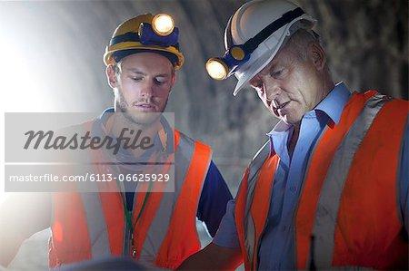 Workers talking in tunnel