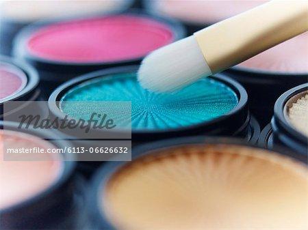 Close up of makeup brush with eyeshadows