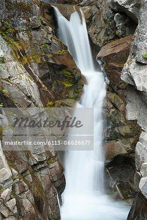 Waterfall on rocky hillside