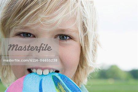 Boy biting lollipop