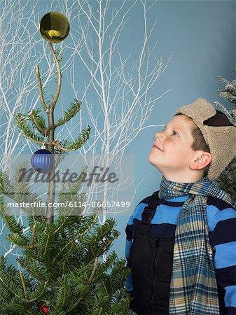 Boy looking at christmas tree