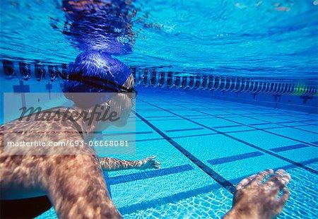 Caucasian female swimmers swimming in pool