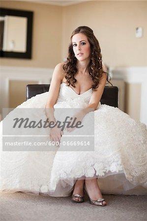 Portrait of Bride sitting in Hotel Room