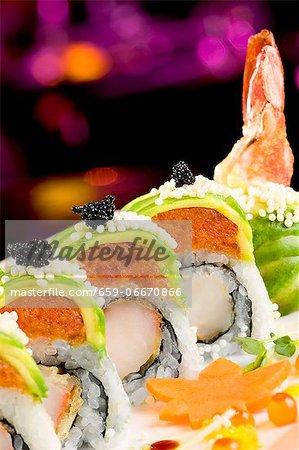 Shrimp Tempura Sushi Roll with Spicy Tuna, Roe, and Avocado