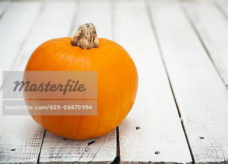 A pumpkin on a wooden table