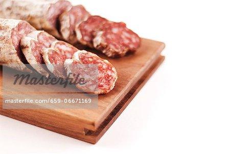 Salami Sliced on a Cutting Board