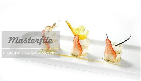 Tiramisu with orange sauce, white chocolate and strawberries