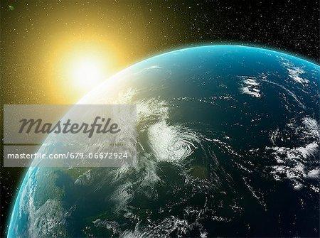 Sunrise over Earth, computer artwork.