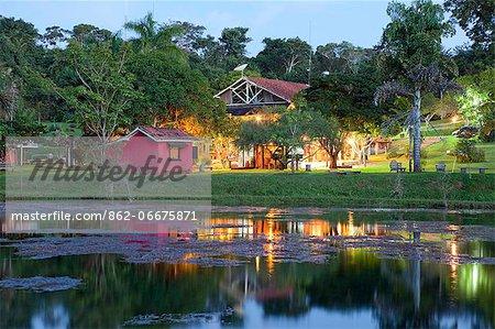 South America, Brazil, Mato Grosso, Sao Jose do Rio Claro, the lake, main buildings at the Jardim da Amazonia jungle lodge and pousada in the Brazilian Amazon