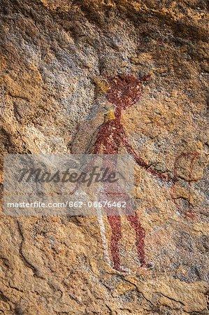 Chad, Bakabi, Ennedi, Sahara. A bichrome figure with a bow in his left hand.