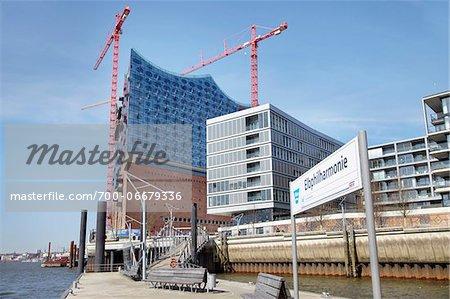 Ferry Dock at Elbe Philharmonic Hall with Construction Cranes, Elbe River, HafenCity, Hamburg, Germany