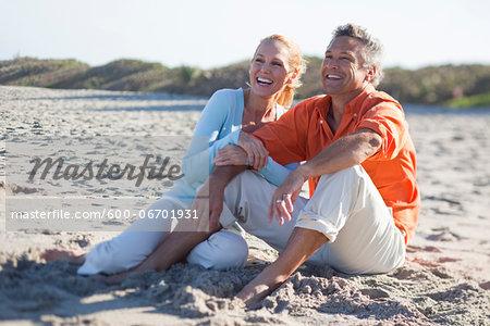 Mature Couple Sitting on Beach, Jupiter, Palm Beach County, Florida, USA