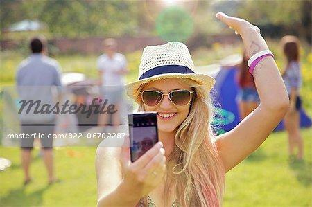 Teenage Girl Taking Self Portrait Photo