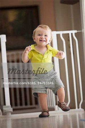 Baby boy learning how to walk, Block Island, Rhode Island, USA