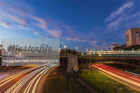 Traffic on the road in a city under the bridge, Storrow Drive, Charles Street, Charles MGH Station, Longfellow Bridge, Boston, Massachusetts, USA