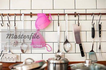 Pink bra hanging in kitchen