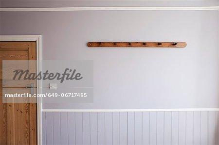 Empty coat rack on wall