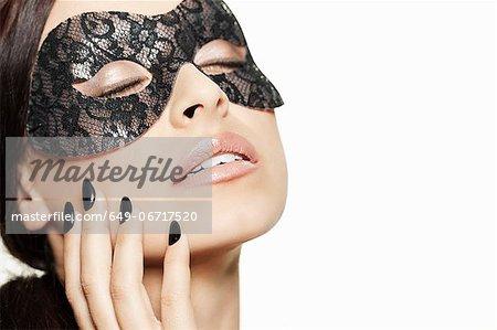 Woman wearing lace mask
