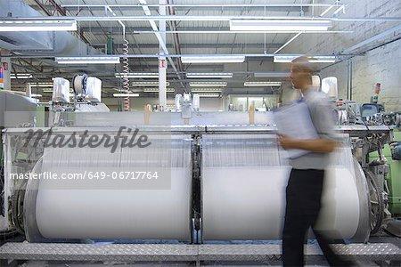 Worker walking in textile mill