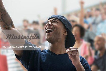 Man cheering at sports game