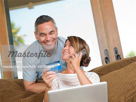 Couple shopping on telephone
