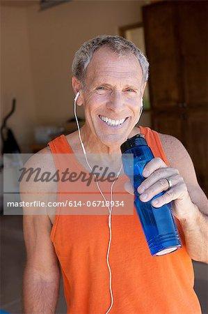 Older man drinking water bottle