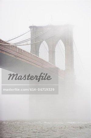Fog rolling over Brooklyn bridge