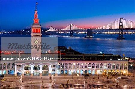 San Francisco building and bridge at night