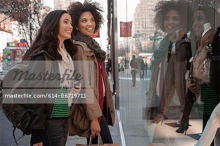 Women window shopping on city street